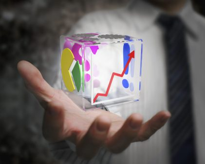 businessman hand holding colorful transparent glass cubic